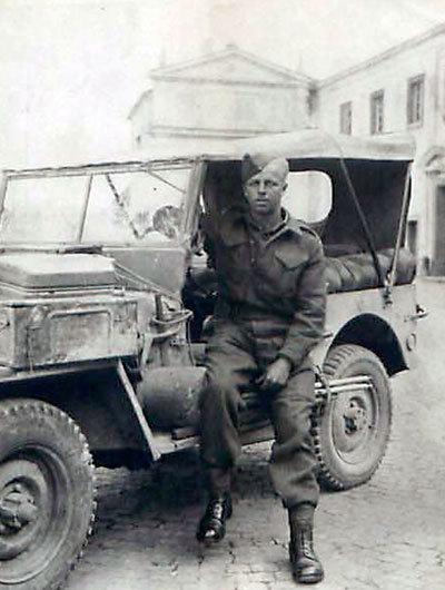 "Photo: Dave King posing next to a jeep - date unknown. As a driver, Dave was the preferred choice for Major 'Jack"" McDougall, head of the Canadian Army Film & Photo Unit. Dave said, ""He seemed to like me."""